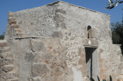 Trullo with olive trees for sale near the nature reserve of Torre Guaceto in Apulia